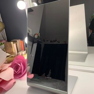 Medium sized makeup or desk mirror with stand